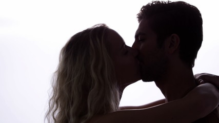 Couple standing and kissing