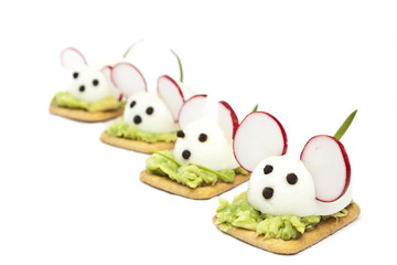 Mice made with eggs, pepper, radish and avocado paste