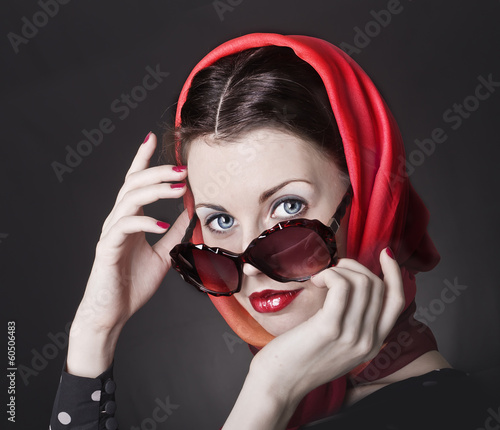 beautiful young woman in big violet fashion sunglasses.