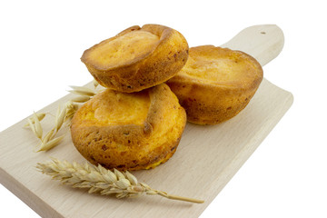 Corn muffins on a cutting board