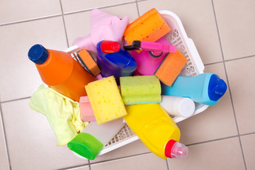 full box of cleaning supplies on tiled floor