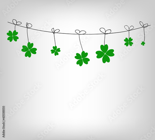 Green shamrocks hanging on a string vector