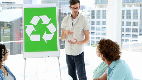 Man present environmental awareness plan to colleagues