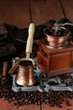 copper coffee pot with beans on a wooden table