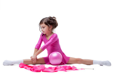 Lovely little girl makes gymnastic workout