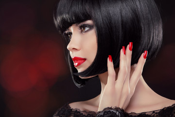 Brunette woman Portrait. Black short hair style. Manicured nails
