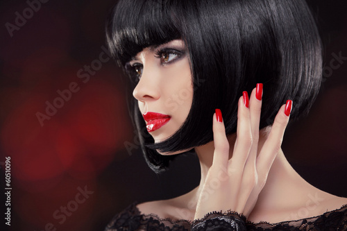 Brunette woman Portrait. Black short hair style. Manicured nails