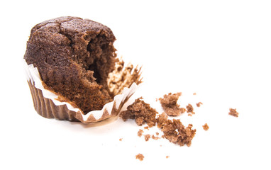 Half-eaten chocolate muffin