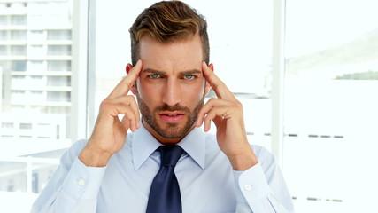 Businessman having a migraine
