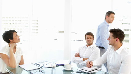 Boss storming off in anger during meeting