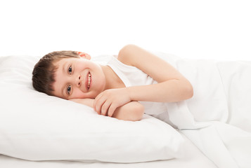 cheerful boy in white bed