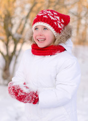 Pretty smiling little girl in wintertime.