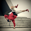 Breakdancer doing one hand stand