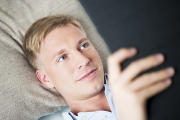 Close up of friendly man relaxing and reading a book.