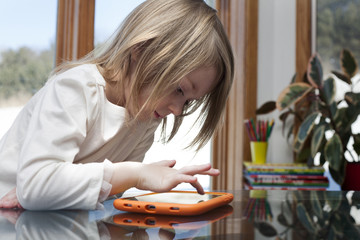 young child in a home in a game on a digital tablet