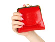 Female hand holding red purse, isolated on white
