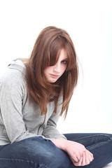 Sad teenage girl alone