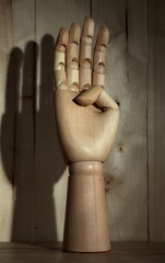 Wooden hand on wooden background