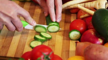 cutting cucumber on a wooden board