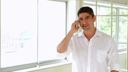 Cheerful man having a phone call