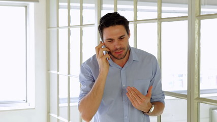Annoyed young man having a phone call
