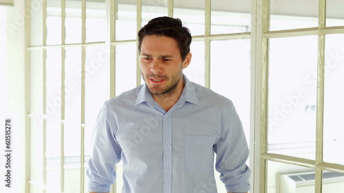 Upset young businessman gesturing