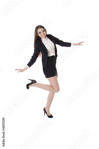 Joyful student girl in uniform dancing