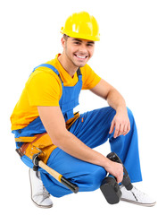 Male builder in yellow helmet isolated on white