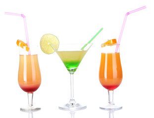 Glasses of tasty cocktails isolated on white