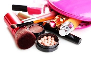 Scattered cosmetics isolated on white