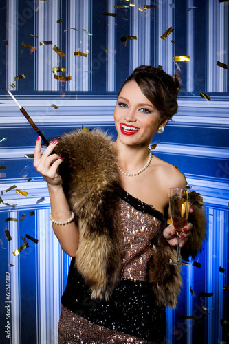 Beautiful girl with glass of champagne