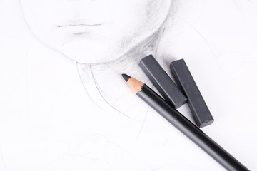 Black drawing charcoals and pencil on picture isolated on white