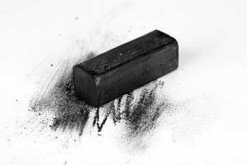 Black drawing charcoal isolated on white
