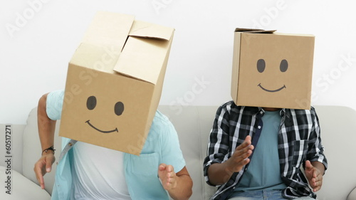 Silly employees with boxes on their heads doing the robot