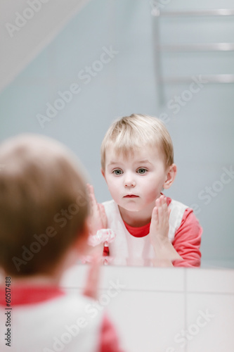 Little girl washing her face