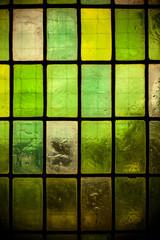 green glass window with regular block pattern green tone