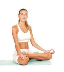 Young lady practising yoga indoors. Isolated on white background