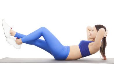 Woman doing abdominal crunches on exercise