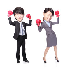 Business man and woman win pose with boxing gloves