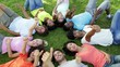 Group of casual young friends lying in a circle