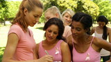 Women organizing event for breast cancer awareness