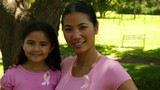 Mother and daughter wearing pink for breast cancer awareness