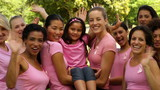 Happy women in pink for breast cancer awareness in the park