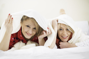 Girls under the quilt