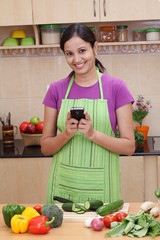 Smiling young woman text messaging