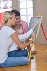 family drawing on school board at home