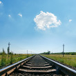 cloud in blue sky over railroad