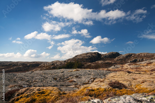 Norwegian mountain landscape with deep blue cloudy sky