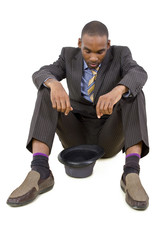 young depressed black businessman sitting in a corner