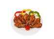 fried chicken wings served with vegetable